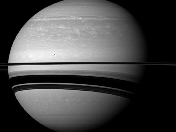 Saturn and its moon Tethys